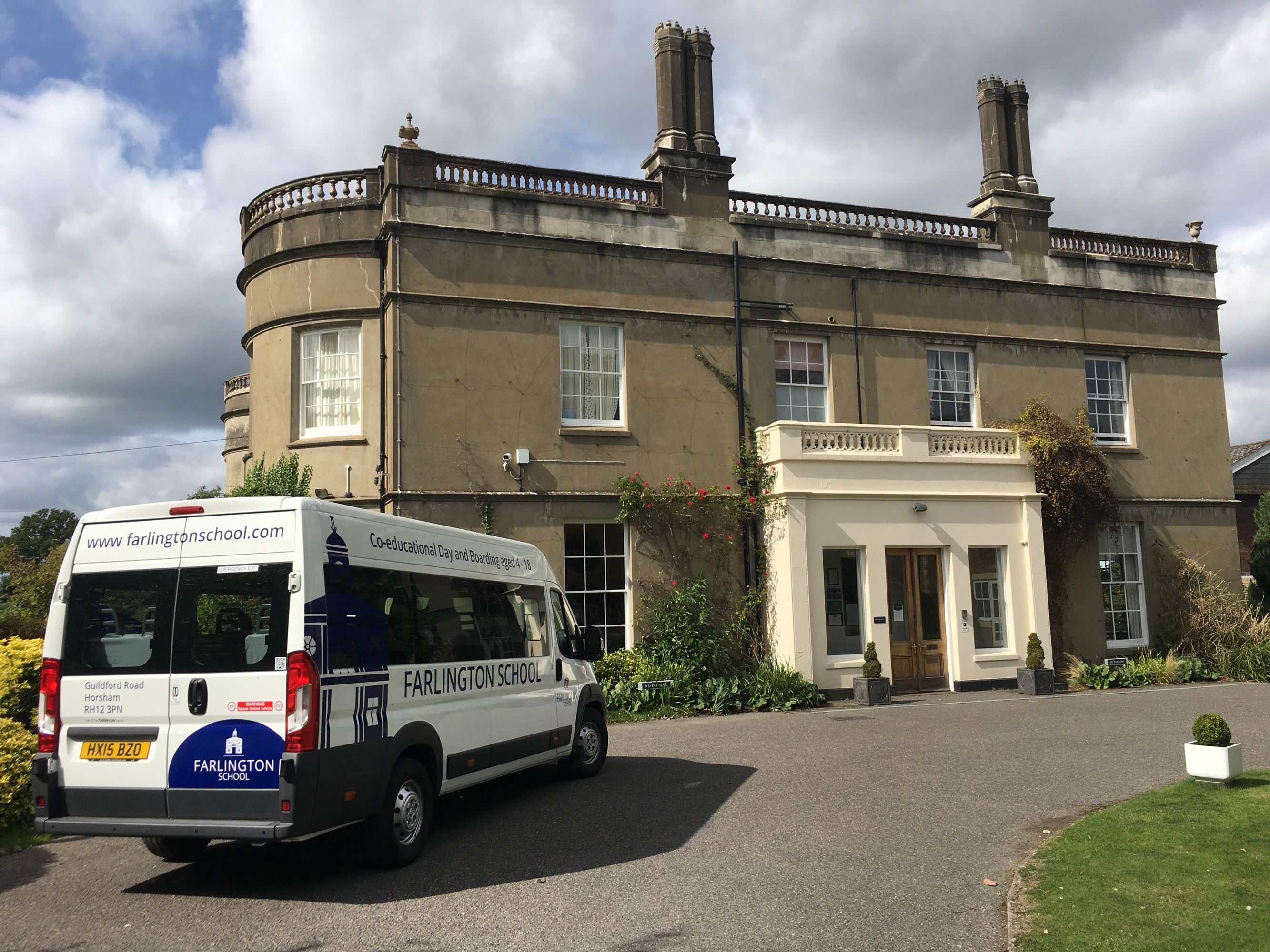 Mansion House entrance with mini bus
